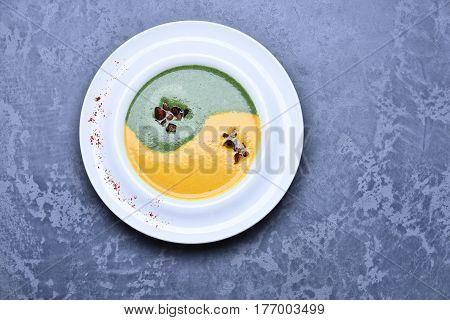 Spinach And Pumpkin Cream Soup Or Puree In Infifnity Sign