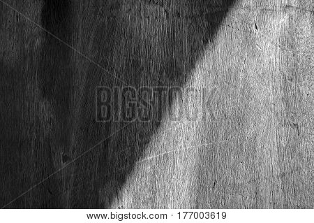 Symmetric shadow on wooden wall monotone photograph