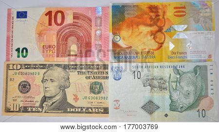 Ten Euro bills, ten dollar, 10 swiss francs, ten rand