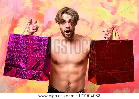 Caucasian Bearded Sexy Macho Man Holding Red Packages Or Bags