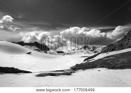 Black And White View On Snow Plateau With Footpath