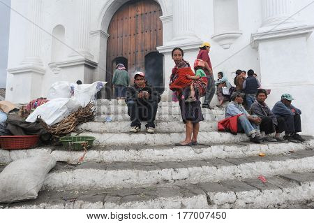 Chichicastenango, Guatemala - 4 February 2014: Indians in front of church of Santo Tomas at Chichicastenango on Guatemala