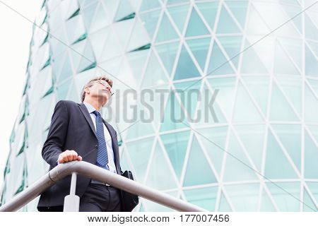 businessman in frankfurt main, skyscraper in the background