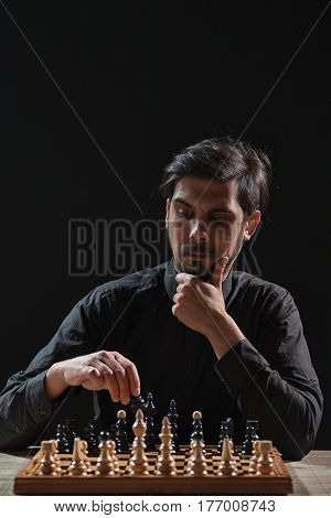 Portrait of adult man who is participating in chess game.