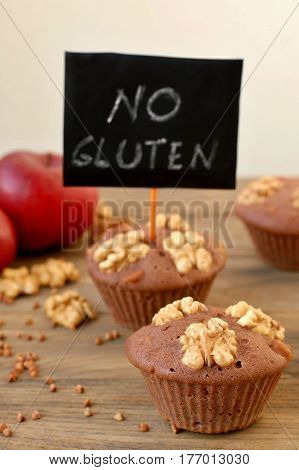 Gluten Free Muffins From Buckwheat Flour, Apple, Cinnamon And Walnuts On Brown Wooden Background Wit