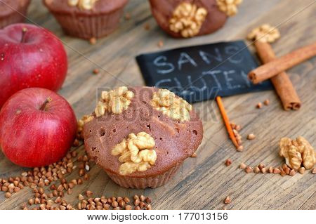 Gluten Free Muffins From Buckwheat Flour, Apple, Cinnamonand Walnuts On Brown Wooden Background With