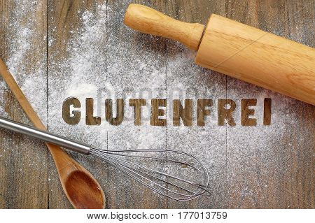 Gluten Free Flour With Text Gluten Free In German Language With Wooden Spoon, Beater And Rolling Pin