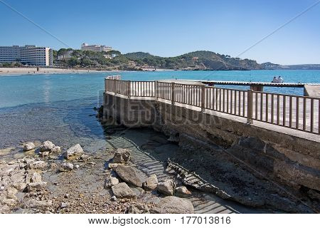 Couple Sit On Wooden Pier