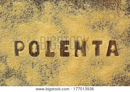Gluten Free Flour Polenta With Text On Brown Wooden Background