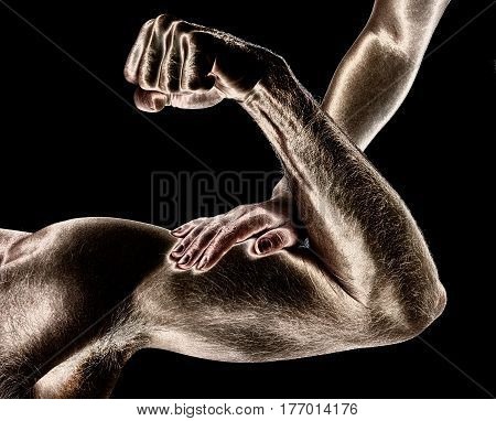 A woman touches a man's muscles on a black background