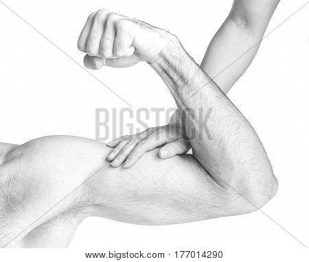 A woman touches a man's muscles on a white background