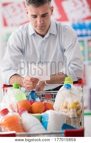 Man Shopping With A Grocery List
