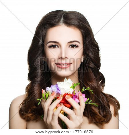 Cute Brunette Woman with Perfect Spring Makeup Colorful Flowers and Curly Hairstyle Isolated on White Background. Beautiful Spa Model with Wavy Hair