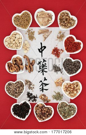 Chinese herb tea selection in heart shaped bowls and loose with calligraphy on rice paper, translation reads as  chinese herb tea. Teas also used in alternative medicine.
