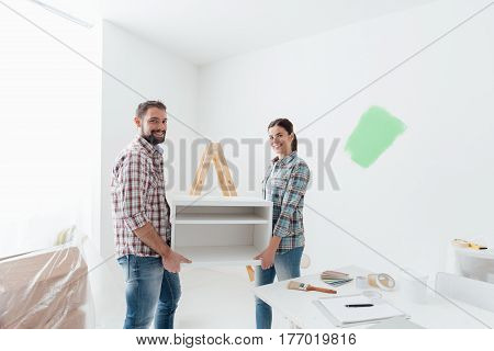 Couple Moving Furnishings In Their New House