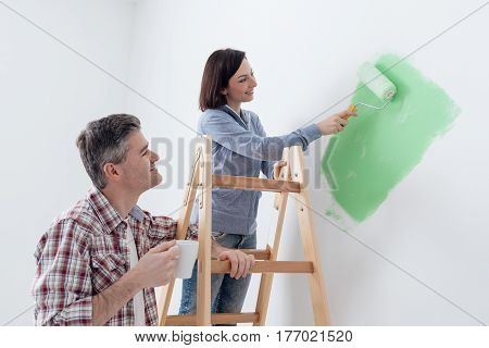 Couple Painting Walls Together