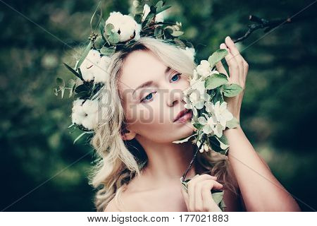 Cute Woman Spa Model with White Spring Flowers Outdoors