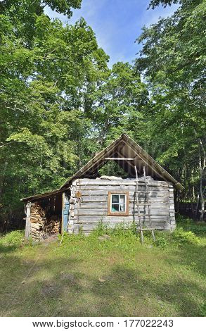 The small log cabin in forest. Russian Far0East.