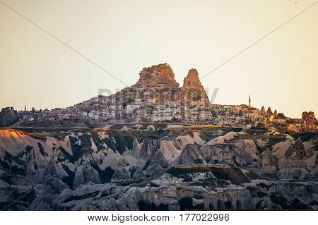 Rock formations landscape photography of Cappadocia in Central Anatolia at sunrise. The great tourist attraction - volcanic mountains in Goreme National Park, outdoor Turkey at early morning