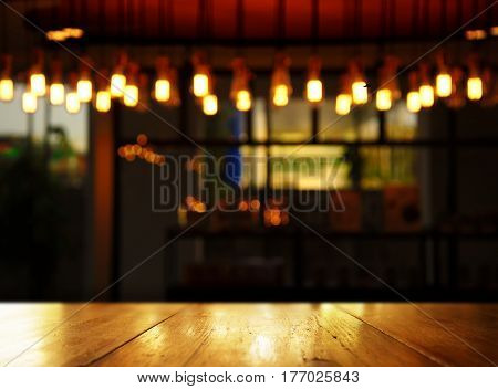 wood background with blur lamp in pub or bar in the dark night background