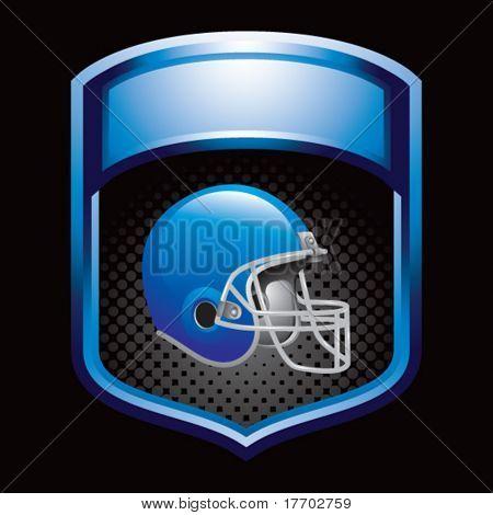colored football helmet on blue display