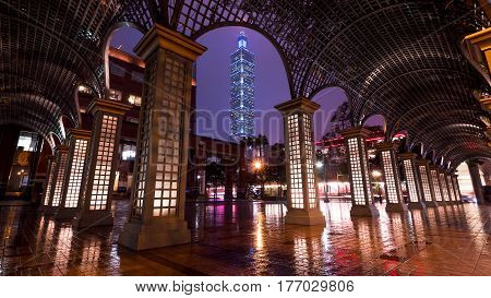 TAIPEI TAIWAN - March 10 2017: Cityscape nightlife view of Taipei 101. Taiwan city skyline at twilight time with corridor foreground.