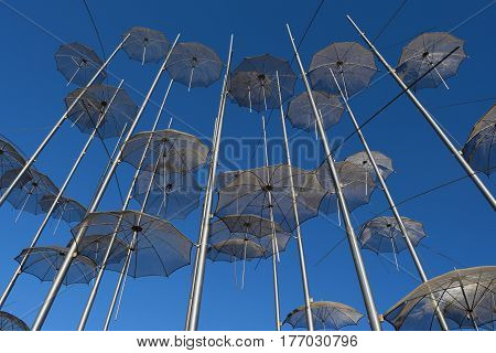 View of the metal umbrellas in Thessaloniki against the blue sky.