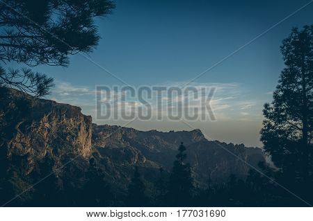 Amazing view of mountain peaks with beautiful clouds on the sunset. Location: Gran Canaria, Canary Islands, Spain.