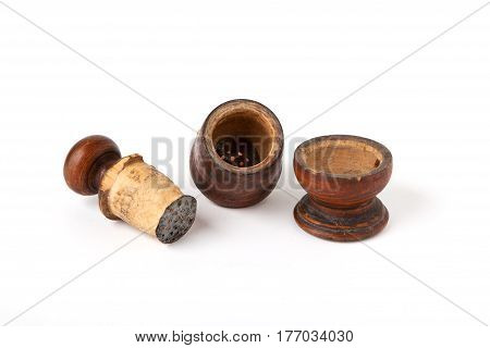 Antique Pepper mill details isolated on white background.