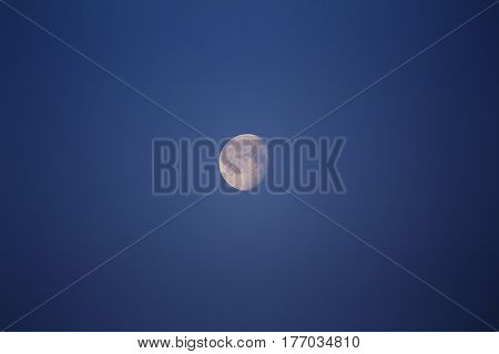 A crisp and clear moon in the night sky