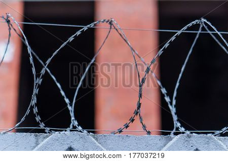 Fence with barbed wire. focus with shallow depth of field