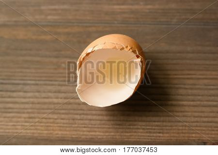 Close-up of eggshell on wooden table surface