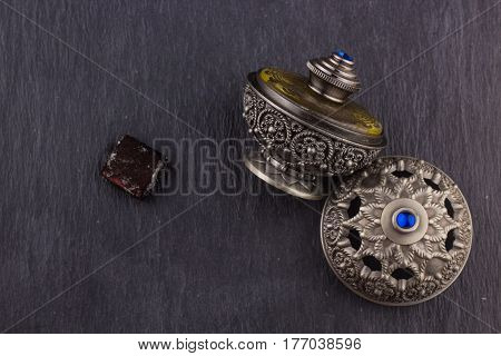 Silver Oriental Artistic Arabian Oud Perfume / Arabian Oud Perfume with Oud Scented Wood burned in the background with Scented Smoke in the Air