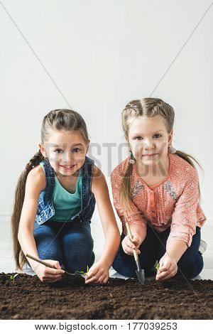 Two girls are thrown the plant for Earth Day.