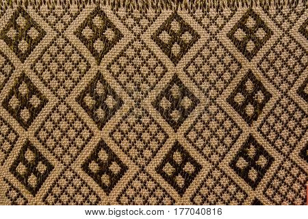Abstract brown textile pattern with geometric background
