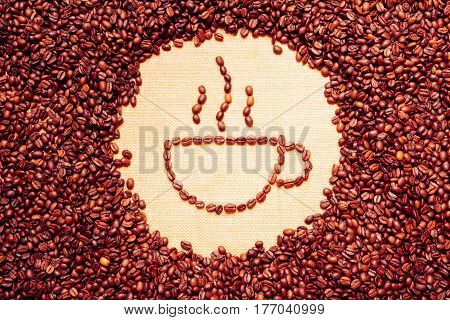 coffee cup symbol made of coffee beans