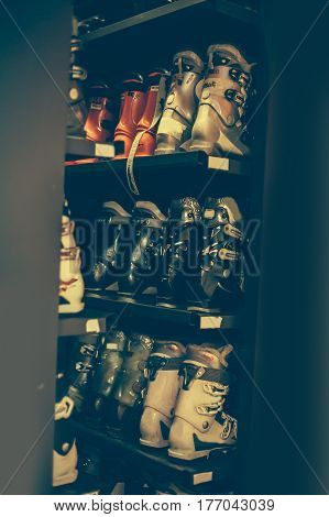 Ski And Snowboard Boots Exposed In The Rental Winter Shop