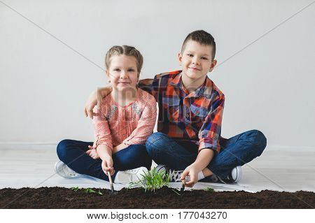 Earth day and the brother and sister are thrown plant.