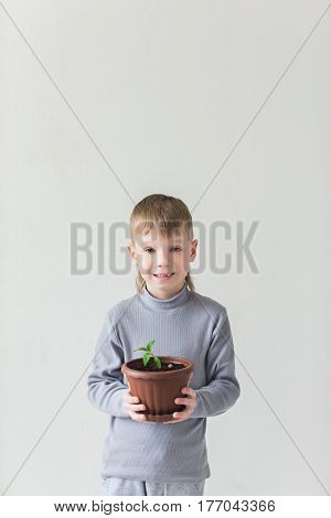 Baby boy and the symbol of Earth Day and ecology.