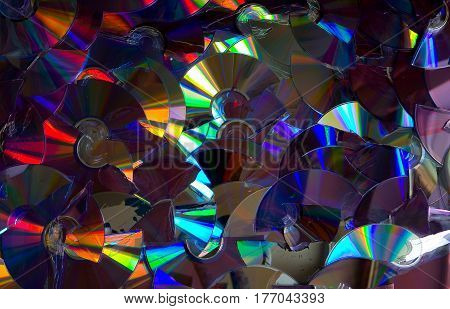 Beautifully iridescent with different colors of broken DVD and CD discs.