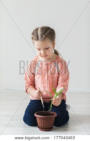 Earth day symbol, the child sits down the plant.