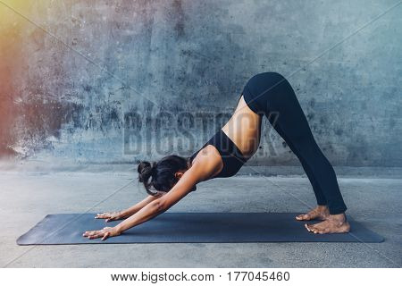 Woman practicing yoga in a urban background