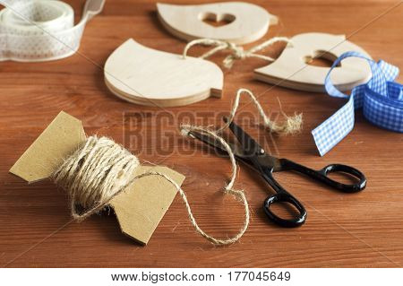 handicrafts made of wood with ribbons on a wooden table