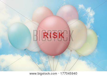 risk on balloon with blue sky background