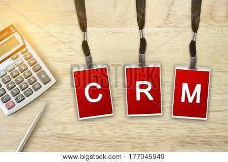CRM or Customer Relationship Management word on red badge with soft light vintage effect