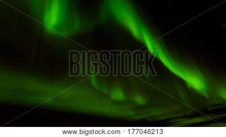 A beautiful green Aurora borealis or northern lights Norway