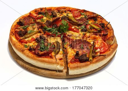 Fresh sliced pizza with sausage mushrooms and hot pepper. Close-up