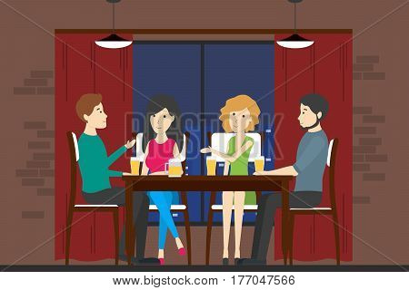 People in bar. Company of men and women sit on the table and drink alcohol and have fun.