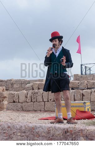 Participant Of Festival Dressed As Clown Shows His Art