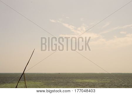 Mat of a dhow on the Indian Ocean with white clouds in a blue sky